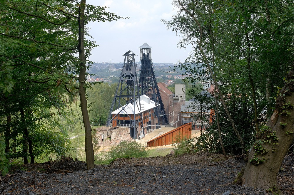 Pictured: the Bois du Cazier colliery from the spoil heap. Travellers will find a singular lens magnifying the mining world during the 19th and 20th centuries. – © Photo-Daylight