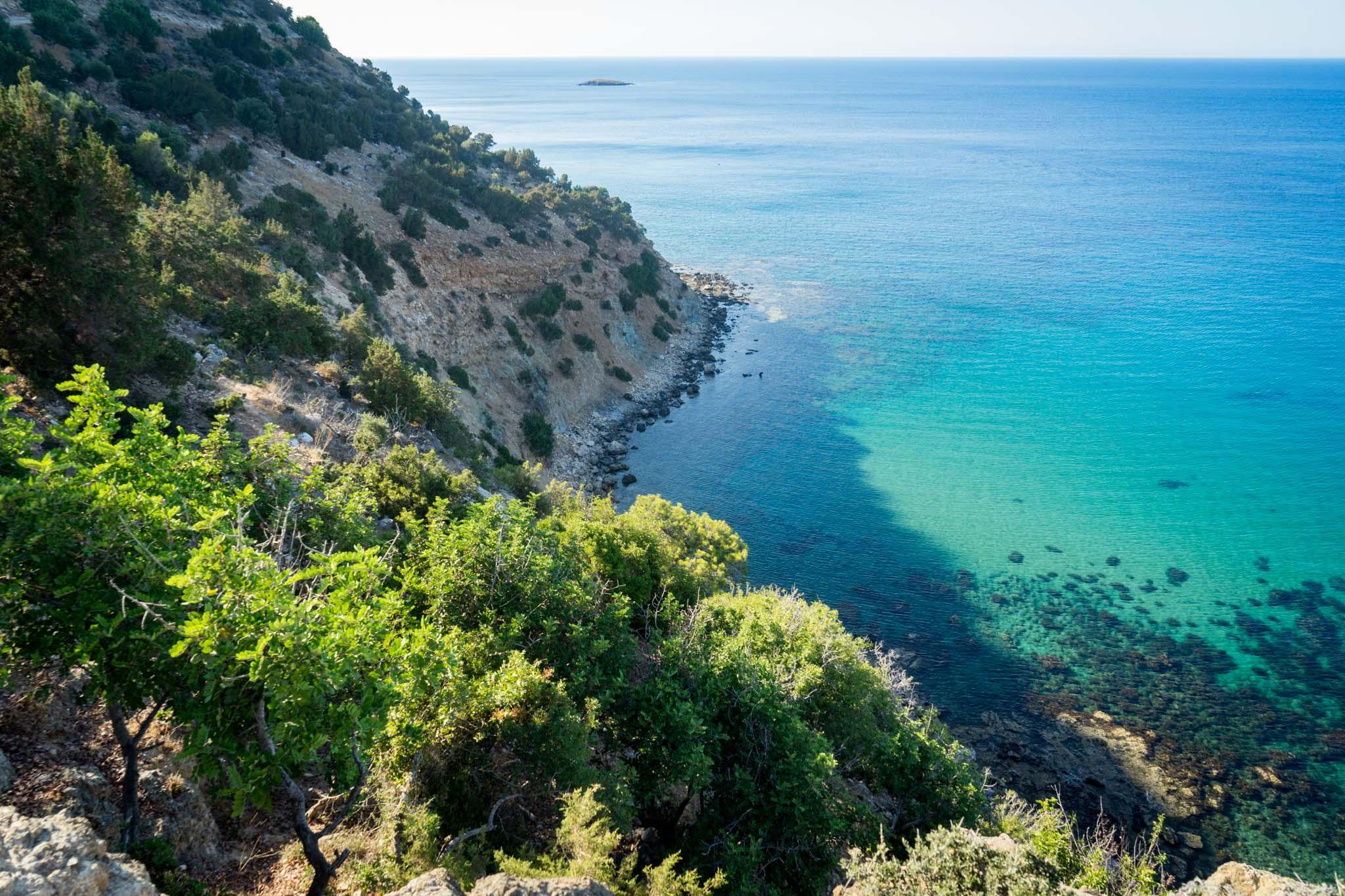 The footpath leading to the Aphrodite bath along the coast offers magnificent views of the sea. The coast is dotted with beaches, some of which have bathing areas. © Michael Turtle