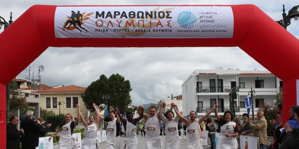 The runners finish the race in Olympia and spread their message to the world. – © Nansy Spyropoulou / Patris Newspaper