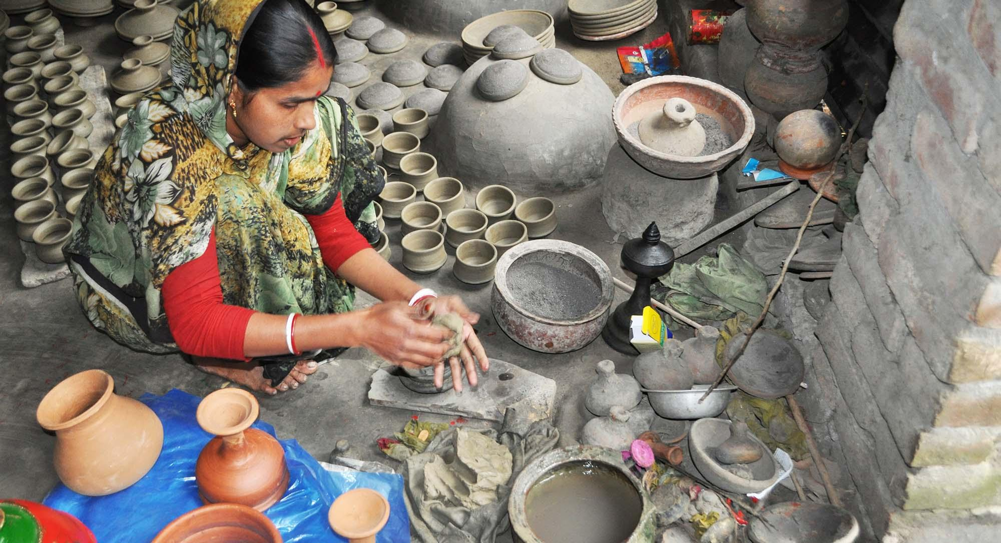 Member of pottery-making community moulding refined mud to create a handmade terracotta bowl, Palpara Paharpur – © Roni Kabir Nurul