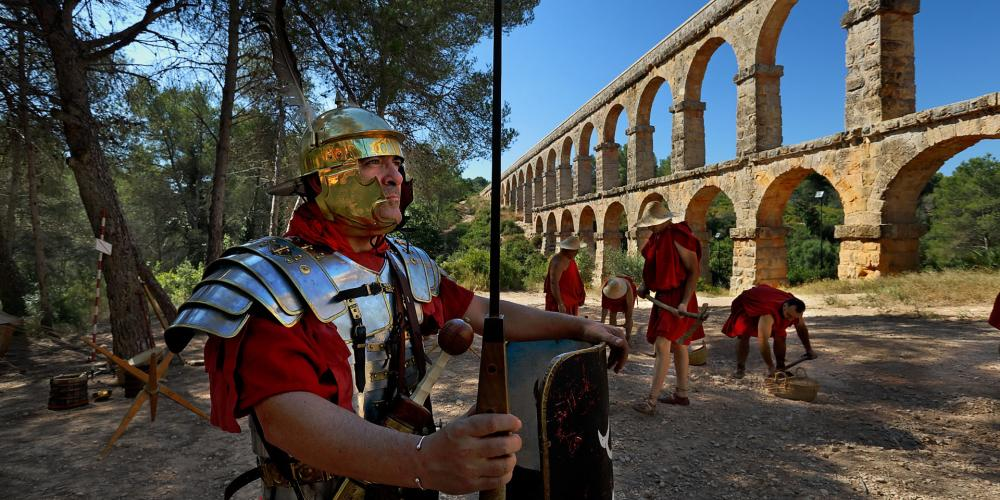 "The Pont del Diable (Devil's Bridge) or the ""Les Ferreres"" Aqueduct—217 metres long and 25 metres high—is only a fragment of a much larger conduit used to supply water from the Francolí River. Here, the archaeological treasure frames Tarraco Viva, recognised as Europe's most important cultural festival celebrating the Roman era. – © Rafael López-Monné"