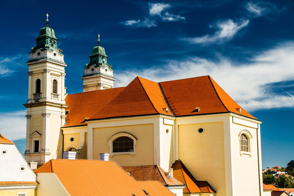 A picturesque small town with a long history, Valtice was first mentioned in 1192. From 1394 until 1939, it served as the Liechtenstein Dynasty's residence. There is a Baroque parish church (pictured) on the square and other historical sites in town. – © ZM_Photo / Shutterstock