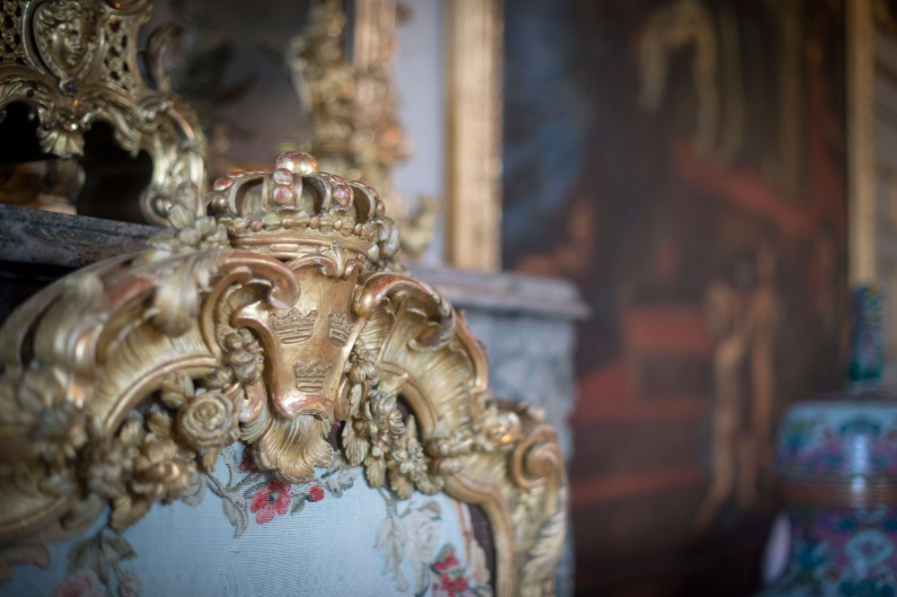 There are plenty of things to discover in every room of Drottningholm Palace. The three Swedish crowns decorate this rococo fire screen in the Ehrenstrahl Drawing Room. – © Kate Gabor