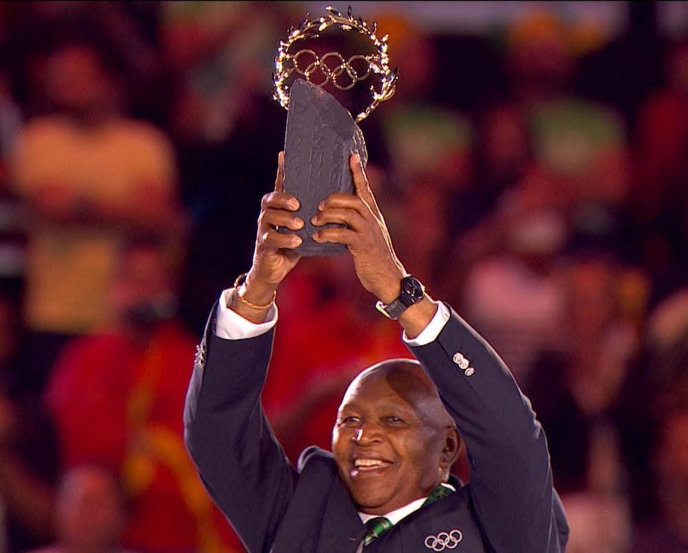 Legendary Kenyan runner Kip Keino becomes the first person to ever receive the Olympic Laurel award thanks to his dedication to education. – © NBC Olympics