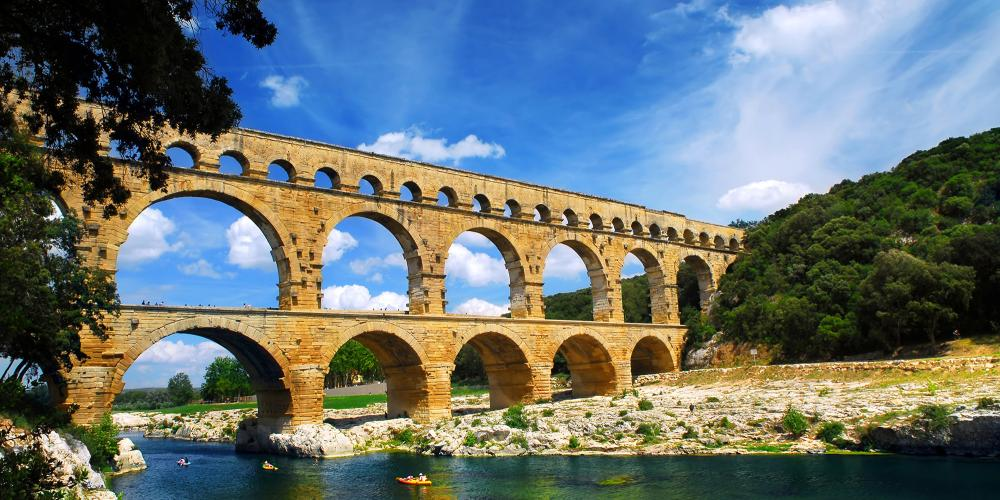 Pont du Gard is part of a Roman aqueduct in Southern France near Nimes. – © Elena Elisseeva / Shutterstock