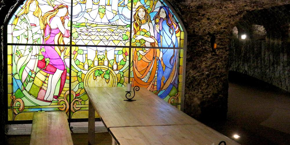 Tasting cellar at Hercegkút Gomboshegy - with decorative painted interior stained glass windows. There are several vintage wines to taste here with Swabian bacon or pike. The local speciality is a thick stew that is served with homemade bread and sour cabbage. – © László Horváth