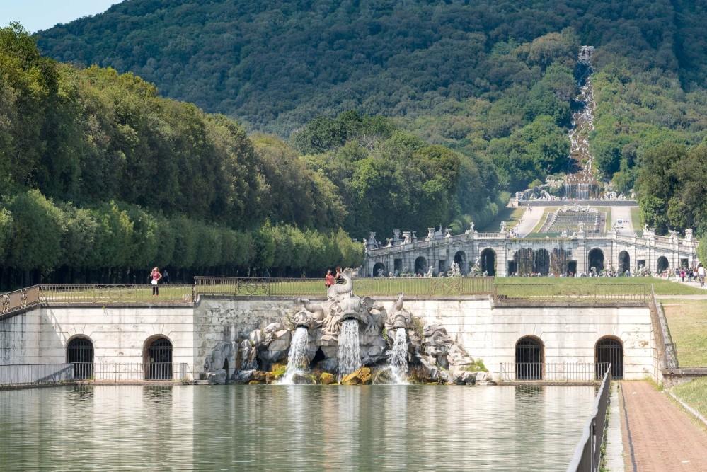 Fontana dei Delfini (Dolphin fountain) and series of cascades, fountains, and basins that extend up the mountain. – © Reggia di Caserta