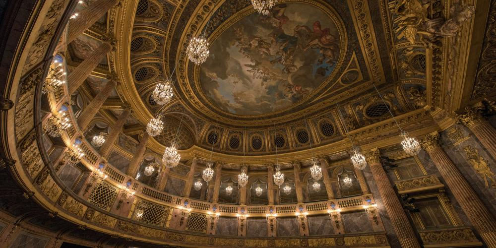 The Royal Opera House is one of the greatest works by the architect Ange-Jacques Gabriel. Inaugurated in 1770 during the reign of Louis XV, it was the largest concert hall in Europe and was also a great technical achievement and an impressive feat of decoration refinement. It has hosted celebrations, shows, and parliamentary debates. – © Thomas Garnier