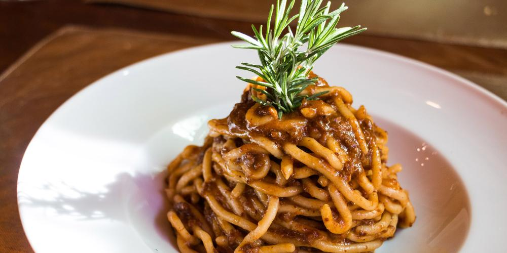 Pici with wild boar sauce. Pici are typical spaghetti only from this region and wild boar is a typical meat. It's very tasty! – © Tina Fasulo / Share your Sangi
