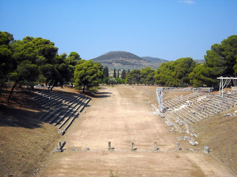 The stadium, built in the 4th century BCE, held athletic games and may have also held performances before the theatre was built. – © Hellenic Ministry of Culture and Sports / Ephorate of Antiquities of Argolida