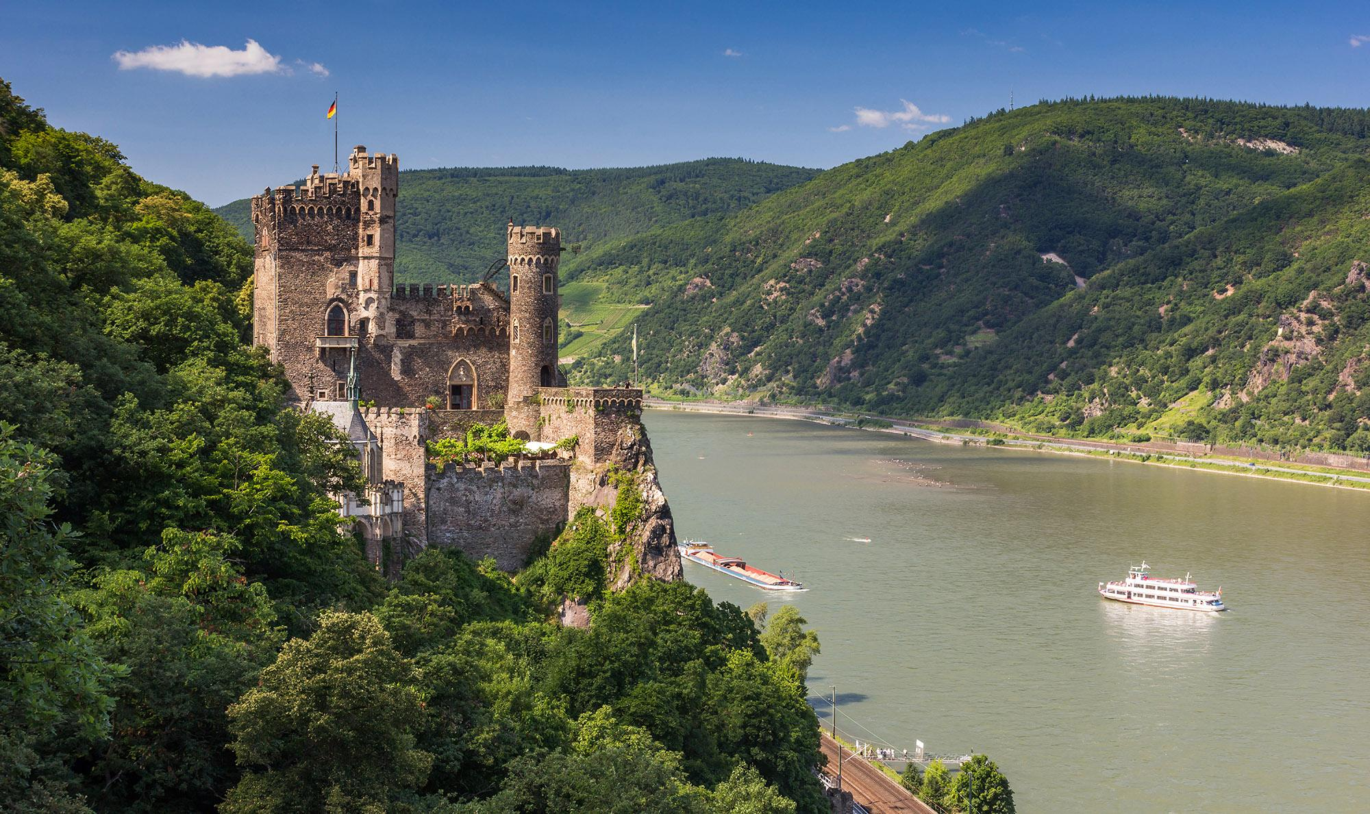 The romantic Rheinstein Castle overlooks the Rhine river. For its diverse culture and undeniable beauty, UNESCO declared the region a World Heritage Site in 2002. – © Kanuman / Shutterstock