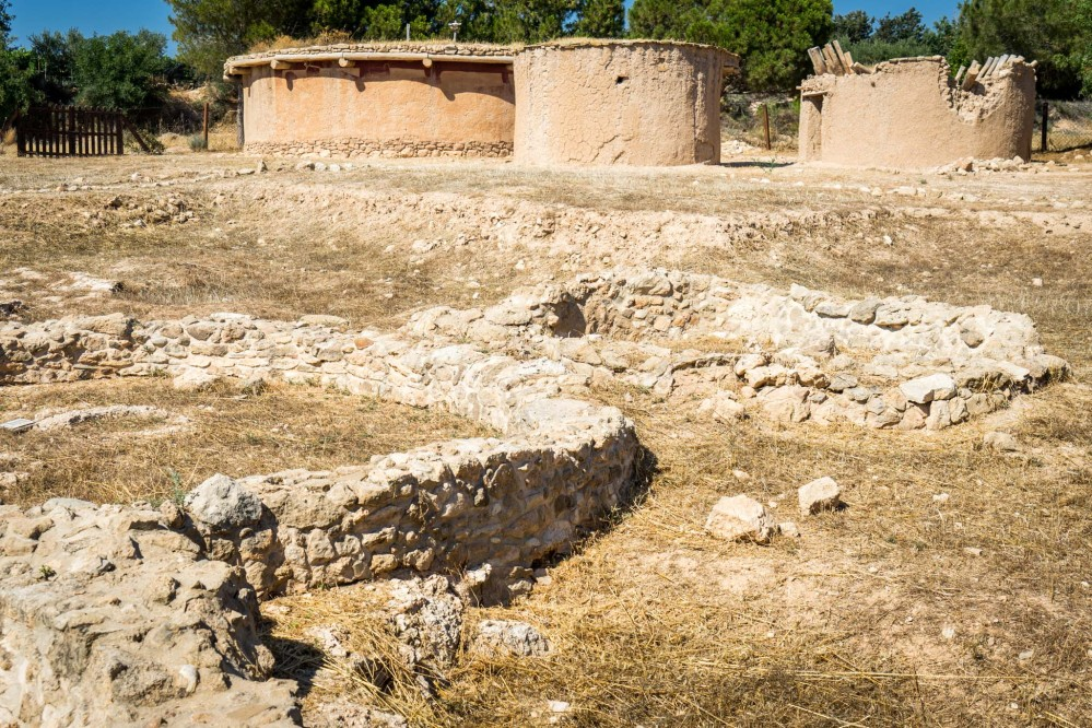 Architectural remains dating back to the Chalcolithic period (3900-2500BC) and constructed replicas. – © Michael Turtle