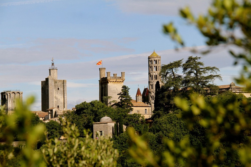 Uzès' three feudal towers. From left to right: the King's tower, the Bishop's tower, Bermonde tower (Duchy's keep) and the Fenestrelle tower. – © City of Uzes