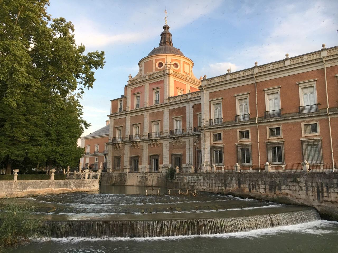 View of the Royal Palace of Aranjuez from the Island Garden, overlooking Castañuelas Waterfall. – © Frank Biasi