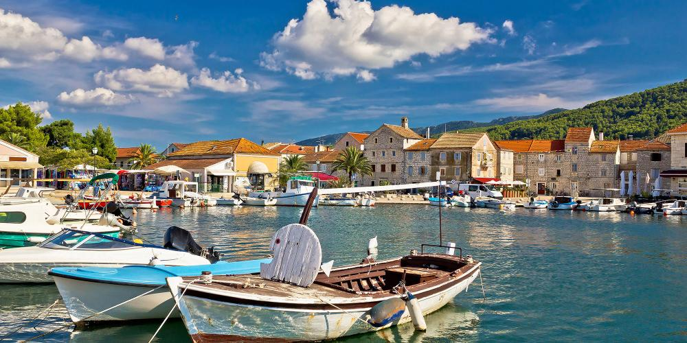 The old town of Stari Grad sits around a harbour where local fishing boats are moored. – © xbrchx / Shutterstock
