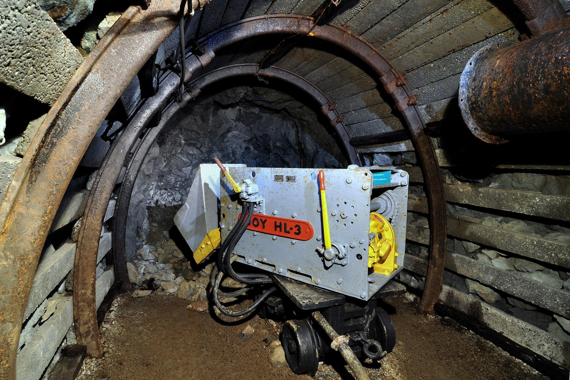 Pieces of broken rock had to be loaded onto mine cars. This mining loader is an example of modern mining technology. – © Lubo Lužina