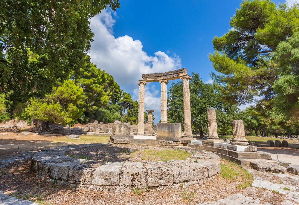 A few moments alone in the ruins of Ancient Olympia—like those of Philippeion—will make any visitor feel like a champion. – © Elgreko / Shutterstock