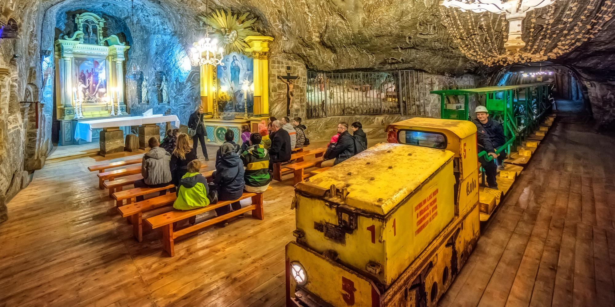 Underground tourist rail tracks in the Bochnia Salt Mine—the only rail track in the world that passes through a chapel interior. – © Adam Brzoza