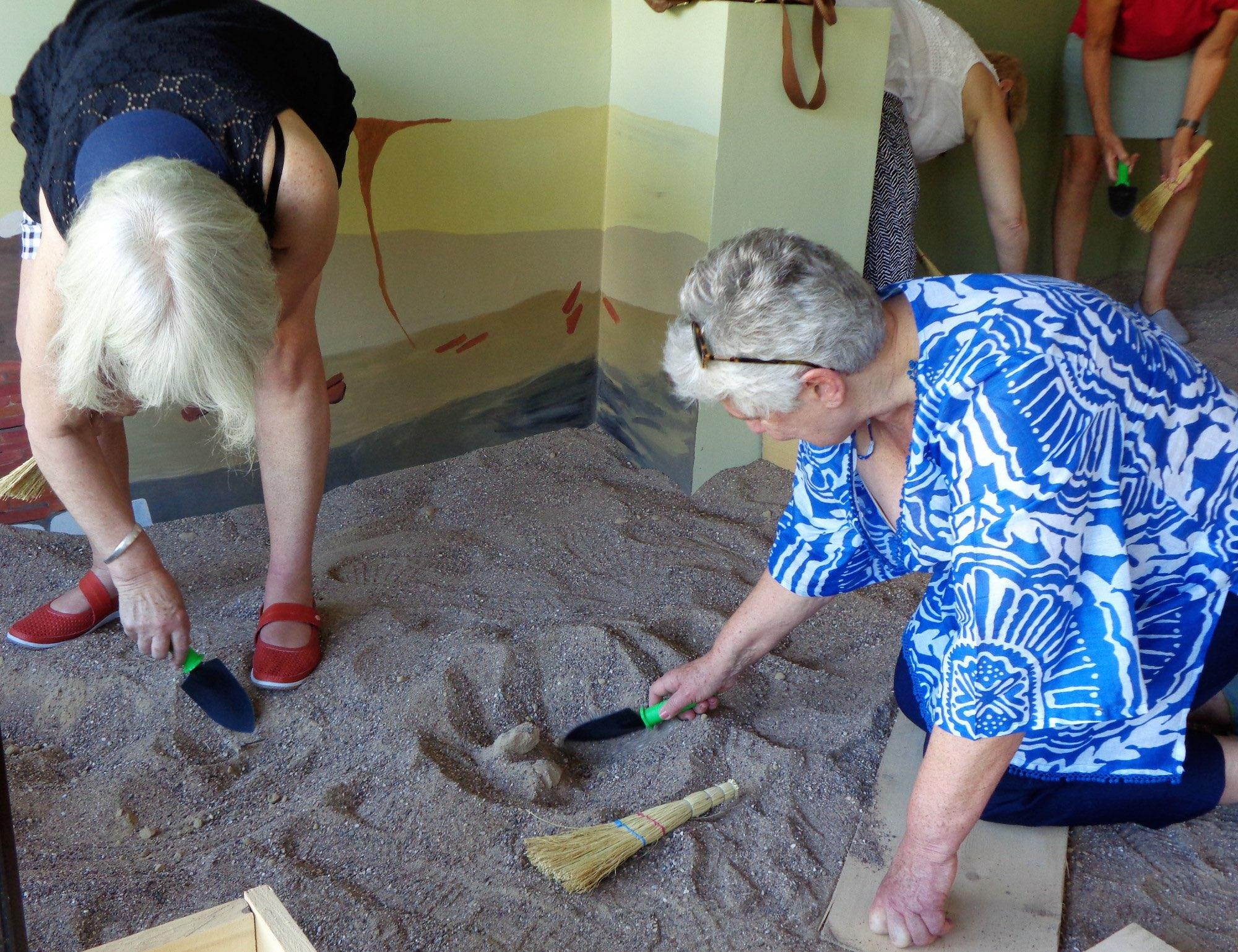 Digging with a group of Australians in the Roman Bath pit before their visit to the archaeological site. – © Dig it