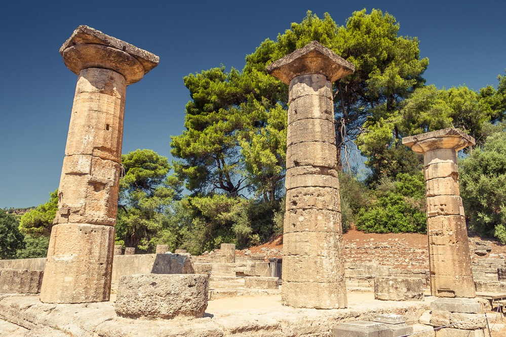 The archaic, Doric temple of Hera, also known as Heraion is dated around 600 BCE and is the oldest temple of Olympia's sanctuary. – © Natalia Evteeva