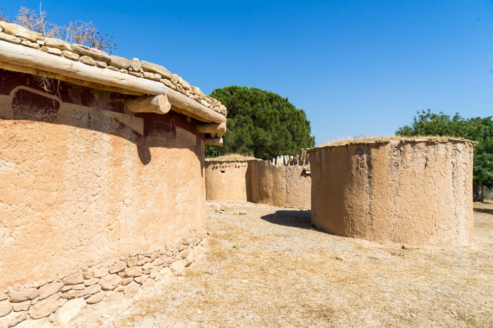 Constructed replicas of houses dating back to the Chalcolithic period (3900-2500BC). – © Michael Turtle
