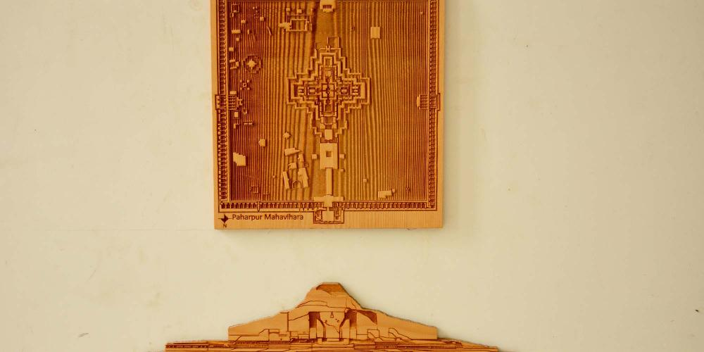 Wood work on the foyer wall of the museum depicting the central temple's elevation and ground plan. – © Md. Shahriar Omar Sadh