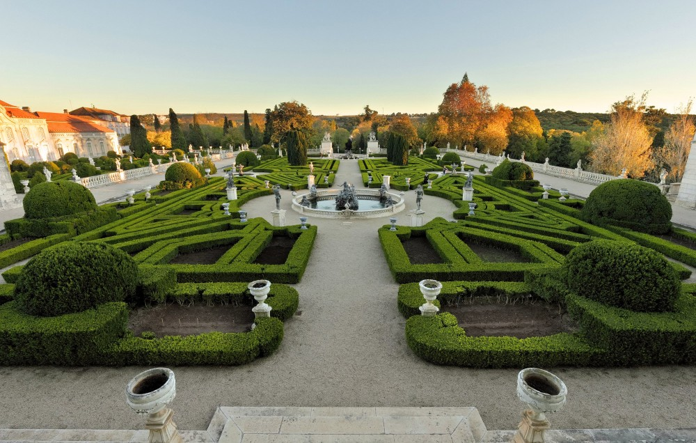 With French influences in their design, the gardens of Queluz are brought to life by water features and statues inspired by classical mythology – © PSML / EMIGUS