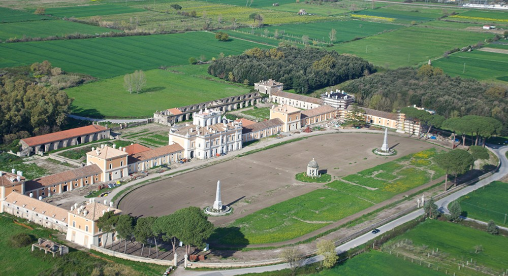 Aerial Photo of the sober and elegant central architectural complex of neoclassical style and dependencies. – © Emma Taricco