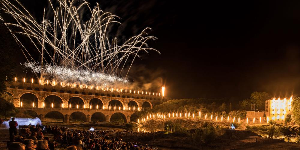 """Les Féeries du Pont"" is an amazing sound and light show in June—and just one of the many events held on the Pont du Gard World Heritage Site. – © Nicolas Chavance / Groupe F"