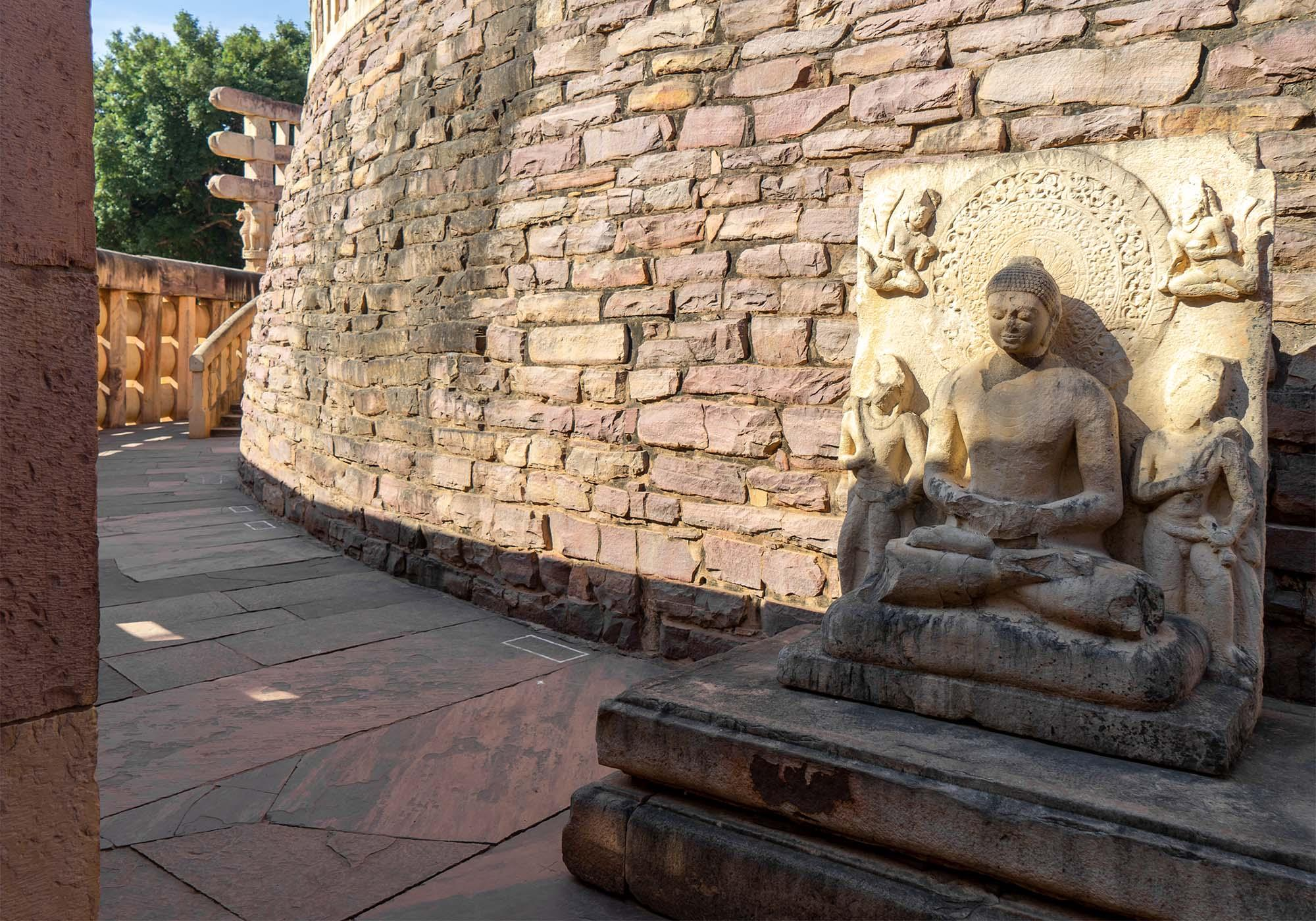 The sculpture of Buddha in dhyana-mudra at the eastern side of the stupa, added to the site in the 5th century AD by the Guptas. – © Michael Turtle