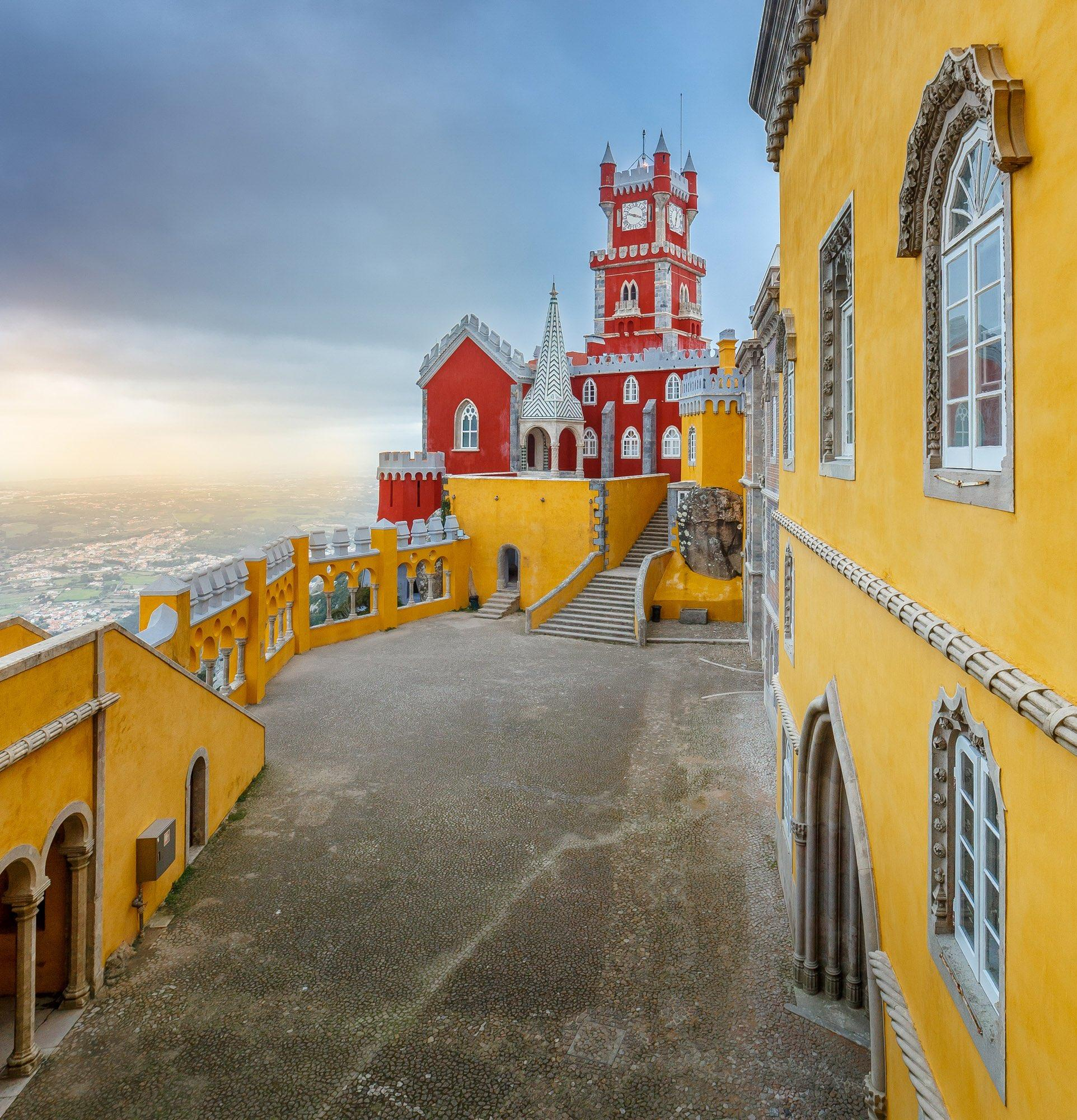 The colourful Pena Palace and the views from its balconies are a highlight of any visit to Sintra – © PSML / EMIGUS