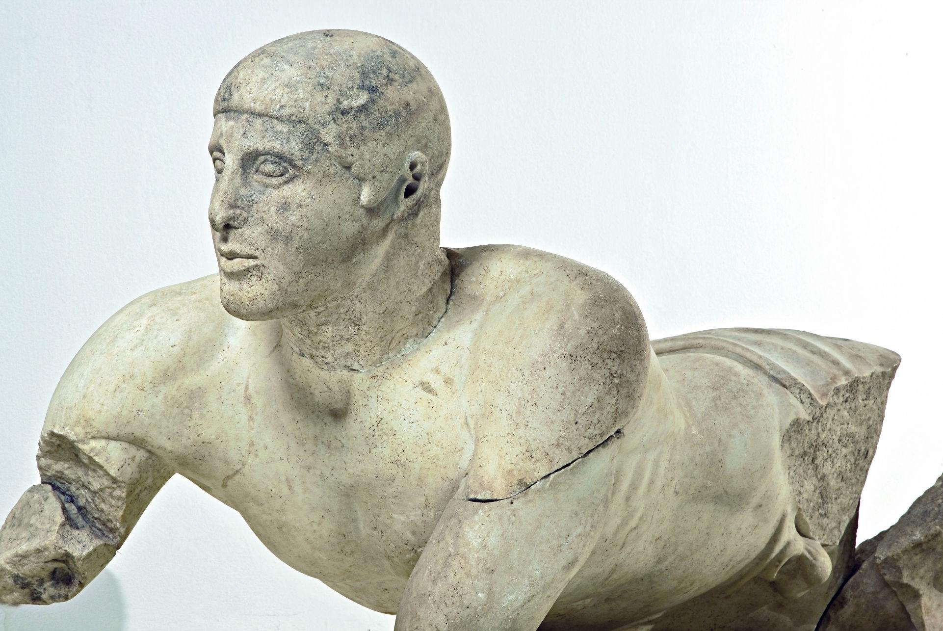 The reclining male figure of the east pediment of the temple of Zeus (Archaeological Museum of Olympia) represents the river Alpheios. – © Hellenic Ministry of Culture and Sports / Ephorate of Antiquities of Ilia