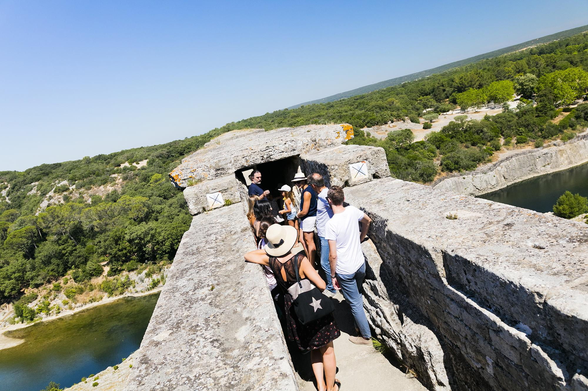 Travellers take a tour across the third level of the bridge into the Roman aqueduct. - © Aurelio Rodriguez