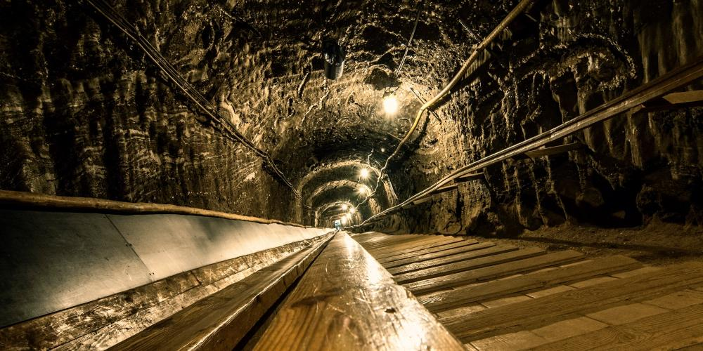 A gigantic slide in the Bochnia Salt Mine. Going down on the wooden slide allows you to reach the largest Ważyn Chamber in an express mode. – © Laura Dec