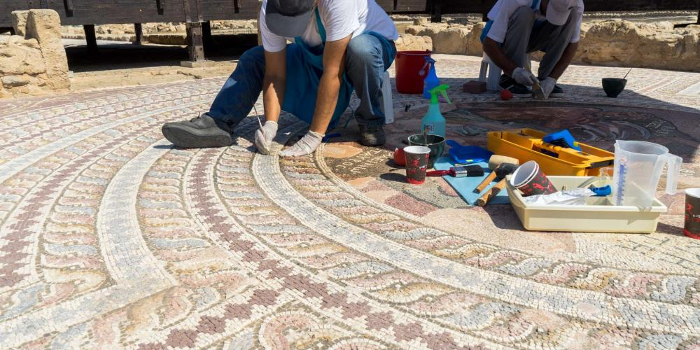 Small brushes, special tools and materials are used to carefully maintain the mosaics. – © Michael Turtle
