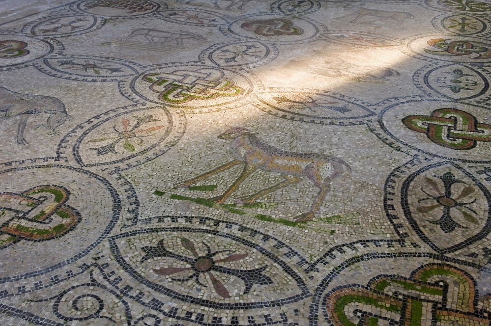 The mosaic floor of the basilica features a host of different patterns, including the animals seen here. – © Gianluca Baronchelli