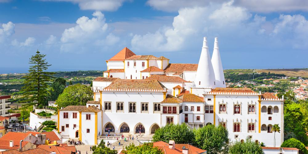 The National Palace of Sintra is the preserved medieval royal residence in Portugal, being inhabited more or less continuously from the 15th to the 19th century. – © Sean Pavone / Shutterstock