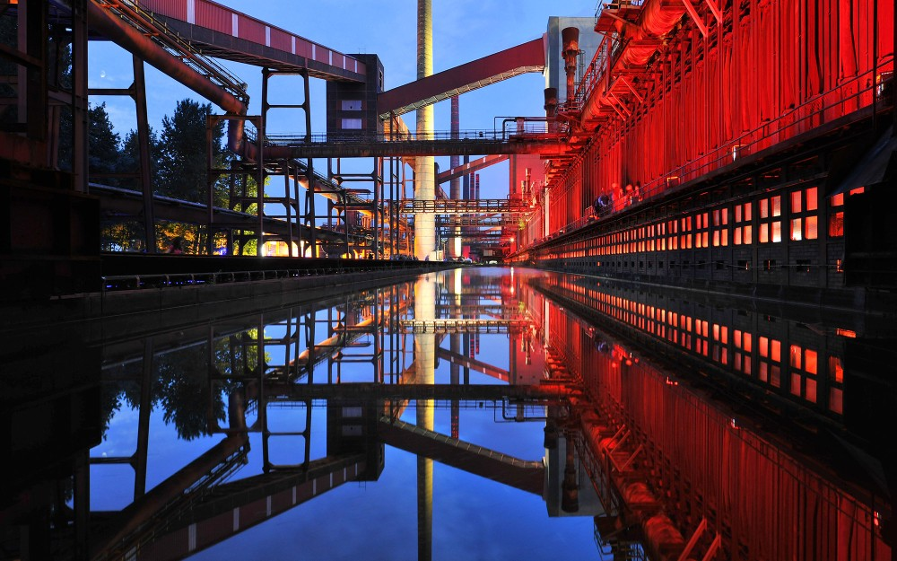 """From 1973 until its closure in 1993, the Zollverein Coking Plant was Europe's largest coking plant. Today, the installation """"Monochromatic Red and Blue,"""" by Jonathan Speirs and Mark Major, turns the coking facilities into an illuminated work of art every evening. – © Frank Vinken / Zollverein Foundation"""
