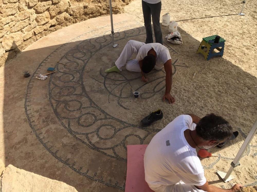 Restorers work on the precious mosaic floor of the Roman Villa in Torraccia di Chiusi.