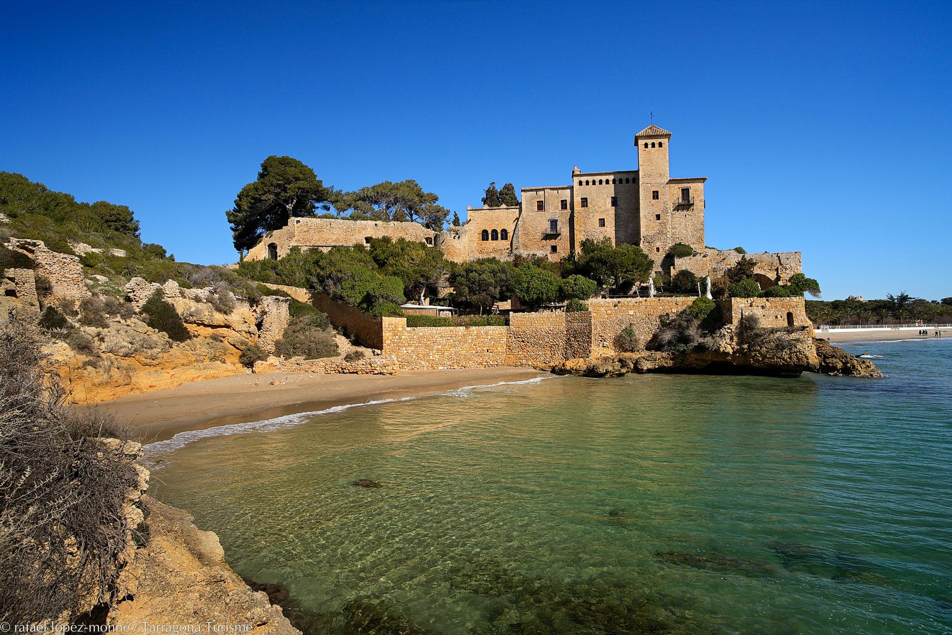 Another major draw for visitors to Tarragona is the city's 15-kilometre coastline, dotted with beaches and coves with crystalline waters. Pictured here is Jovera Cove with its Romanesque and Gothic castle.  – © Rafael López-Monné