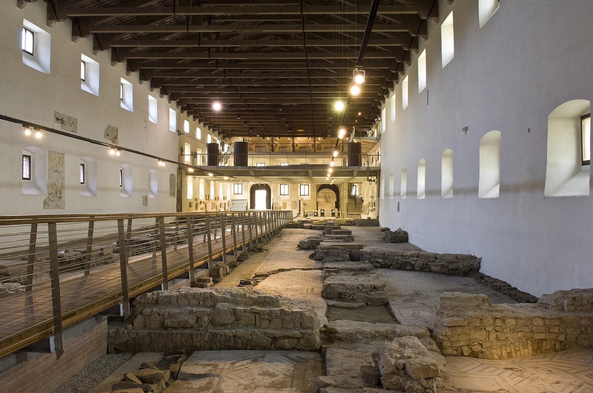 The Early Christian Museum is both a museum and an archaeological site, offering the chance to admire the remains of an Early Christian basilica—above which sits the modern building. – © Gianluca Baronchelli