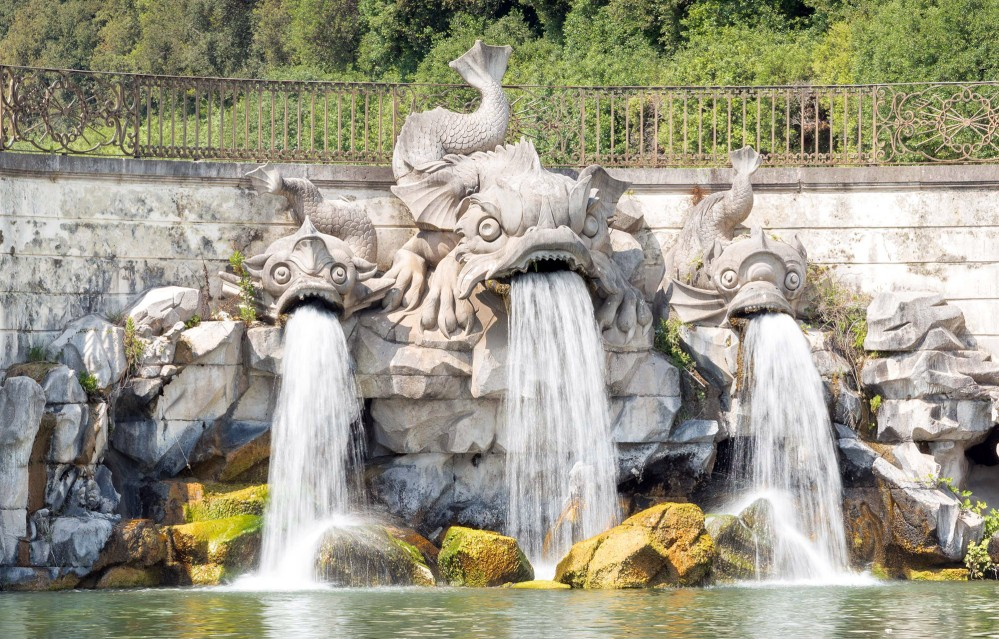Fontana dei Delfini (Dolphin fountain). Construction of the gardens began in 1753, the same year that the Carolino aqueduct was built, which redirects water from the slopes of Mount Taburno to supply the fountains of the royal gardens and irrigate their plants. – © Mariano De Angelis