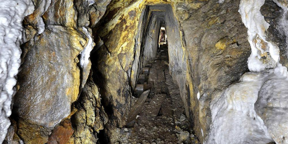 Mining work made manually. Early mining works were very narrow with a low ceiling because it took hard work and a long time to make them using only a mining hammer and mattock. – © Lubo Lužina