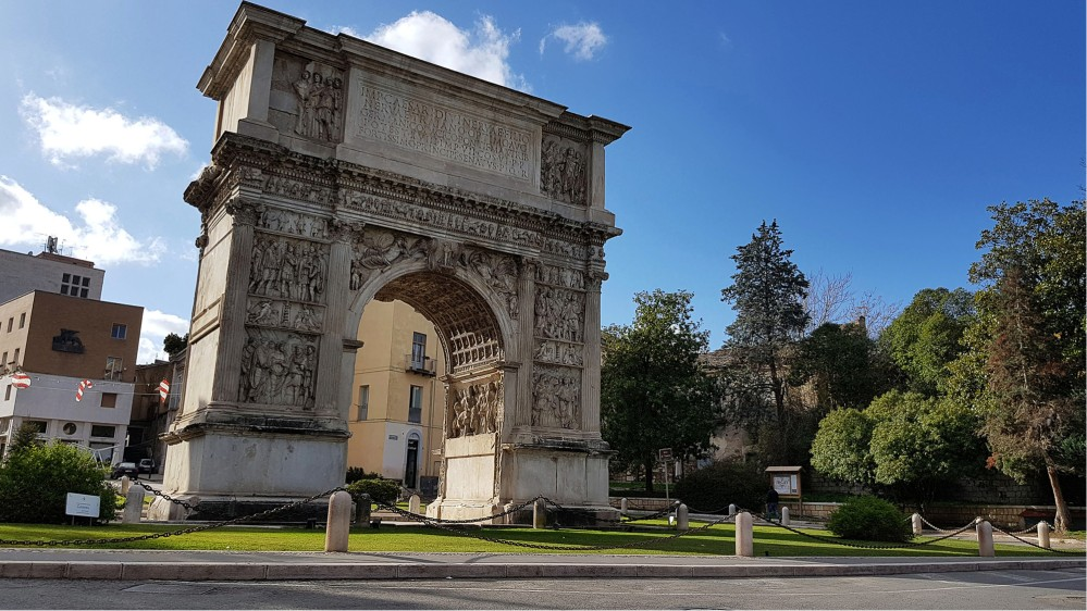The Arch of Trajan is substantially intact, including some of the best-preserved sculptural reliefs decorating any Roman triumphal arch. – © Comune di Benevento