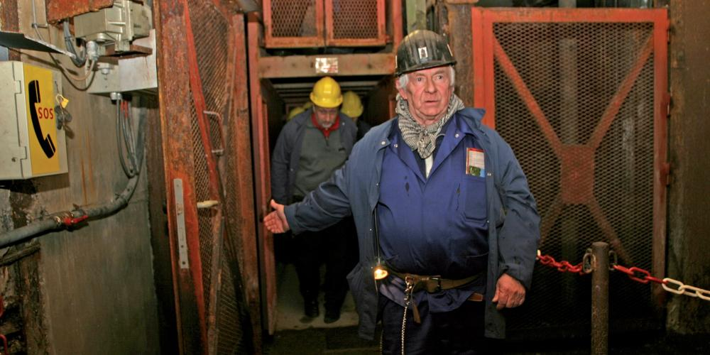 "Tours to the mine take the cage down to discover the mystical world of the ""black rock."" – © Blegny Mine"