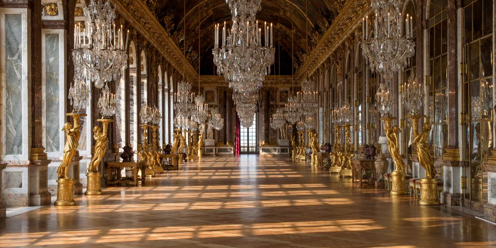 The Hall of Mirrors, the most famous room in the Palace was constructed by Jules Hardouin-Mansart in 1678 and its vaulted ceiling was painted by Charles Le Brun between 1681 and 1684. At that time, mirrors were extremely expensive and the seventeen arches reflected the power and wealth of France. – © Thomas Garnier