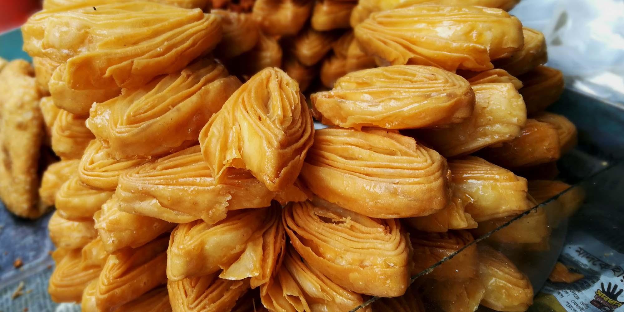 Local handmade Goja sweets at Paharpur Bazar, Paharpur – © Roni Kabir Nurul