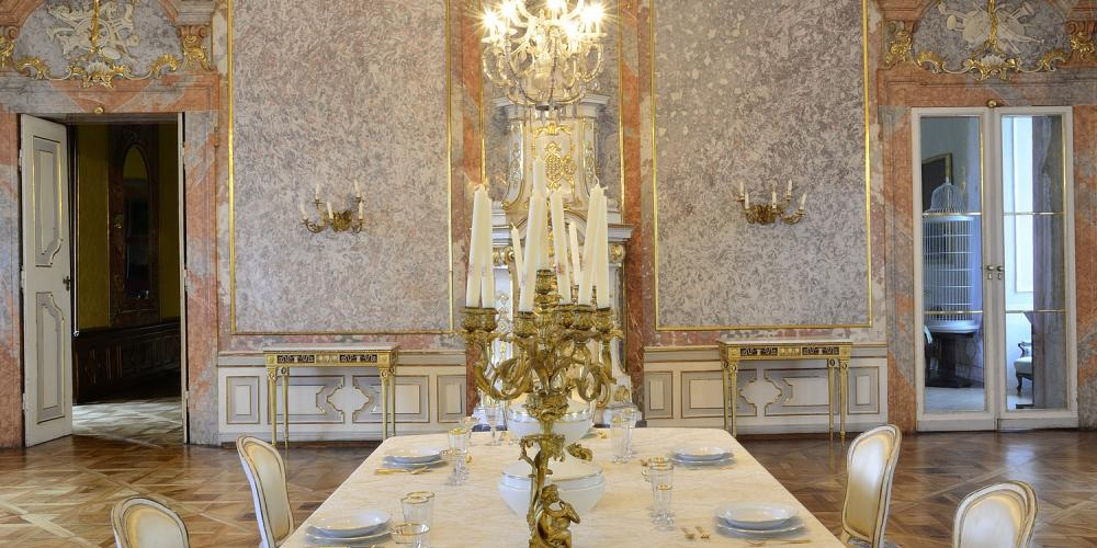 Tour the elegant dining room at Valtice Castle. – © Archive of Valtice Castle