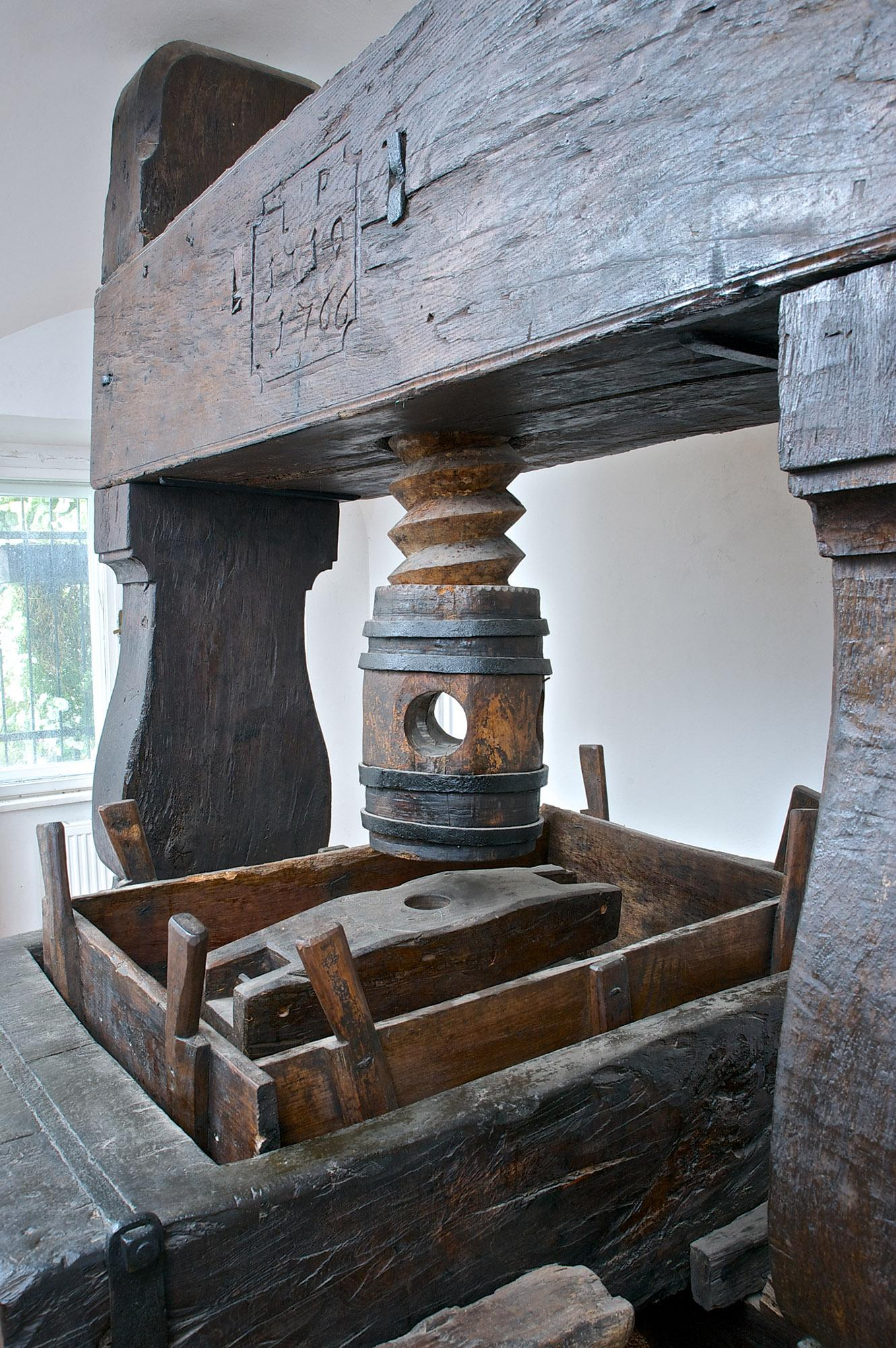 The museum houses a unique collection of wine presses, the oldest of which is a monumental spindle press from 1719, which stands 280 cm (9 feet) tall. – © Dominika Švédová