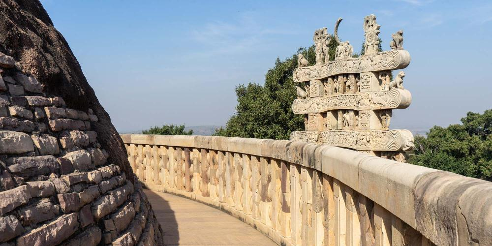 The high terrace that encircles the Great Stupa offers close-up views of the rears of the ornately-carved gateways. – © Michael Turtle